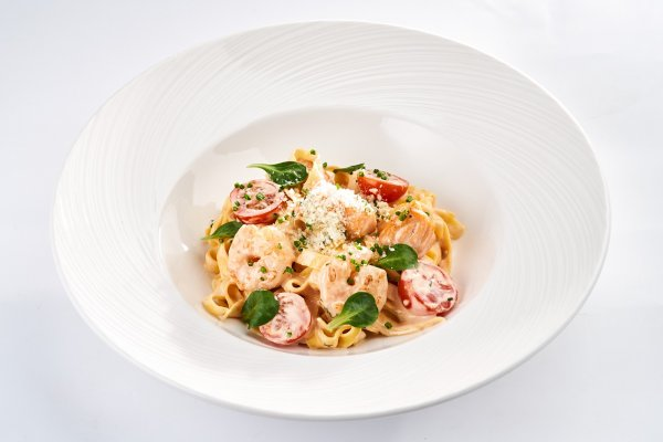 Tagliatelle with «Kimchi» cream sauce with salmon & shrimps