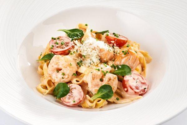 Tagliatelle with «Kimchi» cream sauce with salmon & shrimps