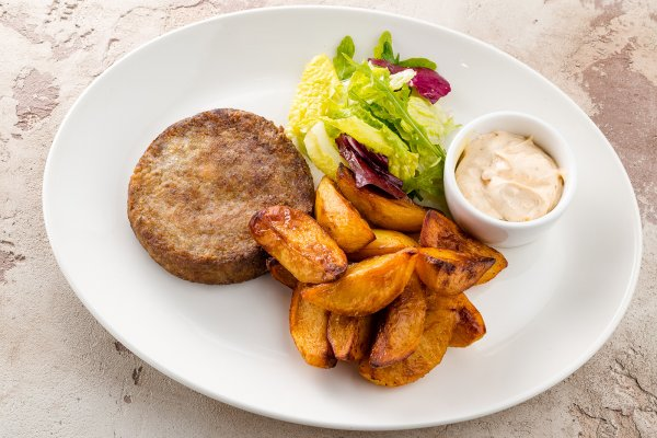 Mushrooms cutlet with fried potatoes and mix-salad
